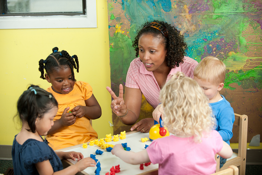 children with caregiver/teacher