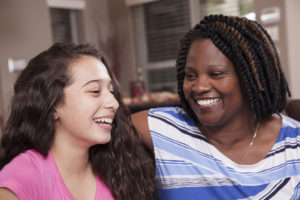 adult and youth talking and smiling