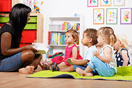 Toddlers watching a teacher