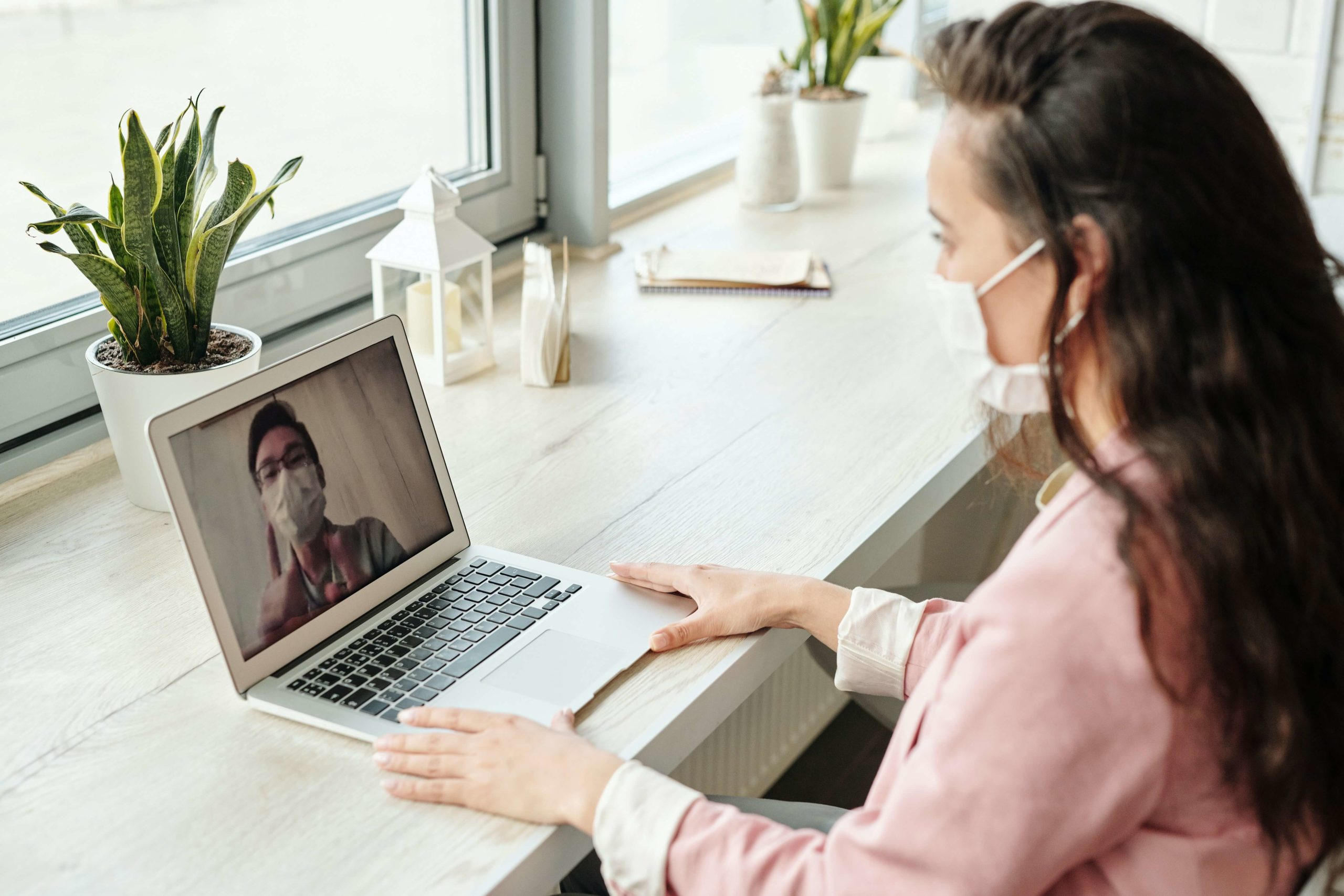 Woman having a telemedicine call with a therapist