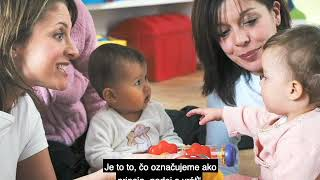 A still from the video The Science of Early Childhood Development with Slovak subtitles, showing two female caregivers holding two babies.
